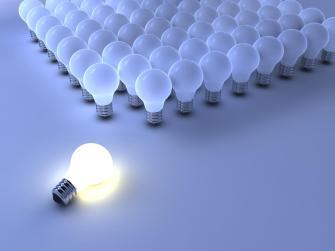 lighted bulb among many_13585792 (Copy)